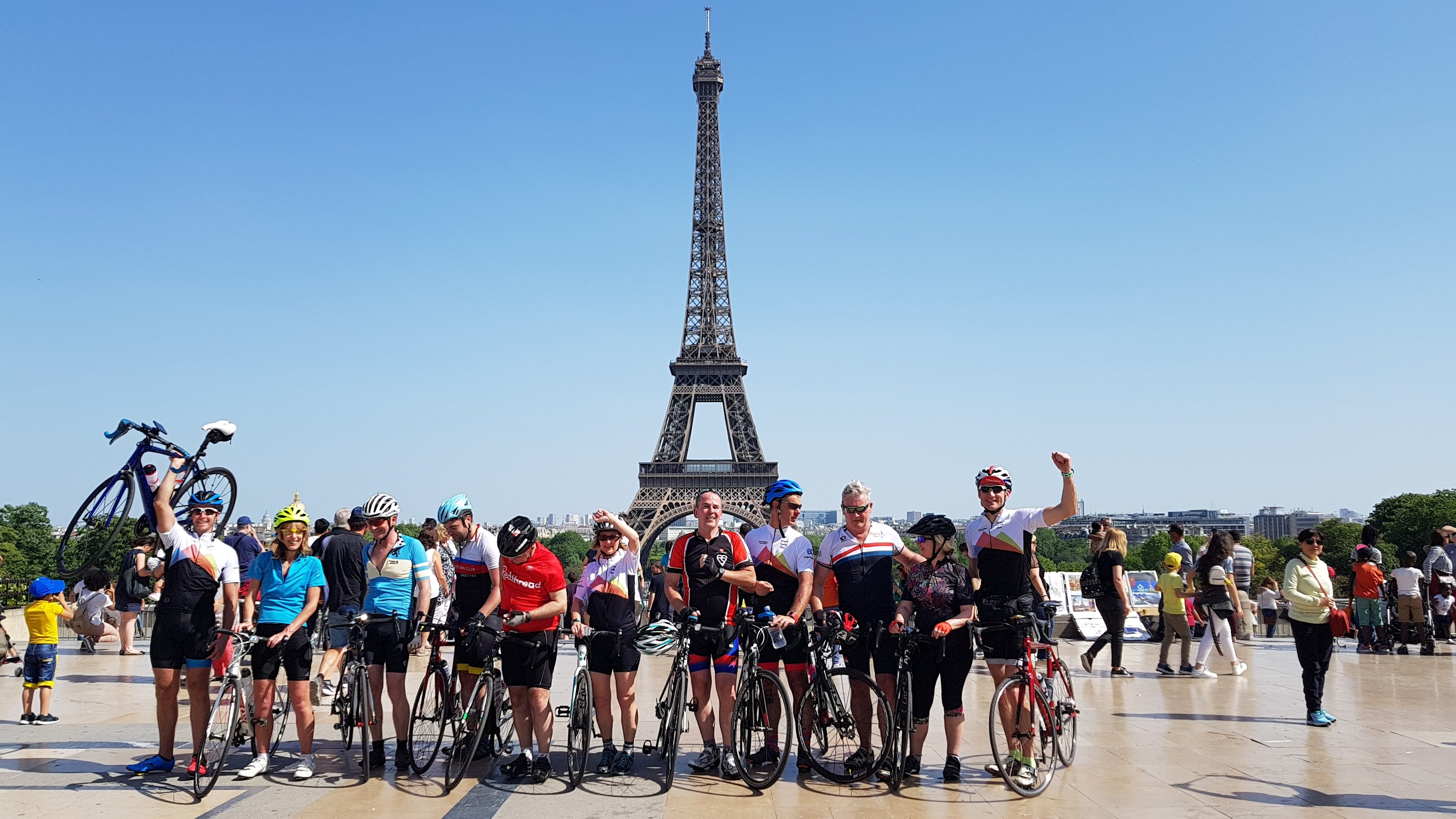 Cyclists finish in Paris cycling the 3 day London to Paris bike ride